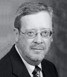 Dr. David E. Procter